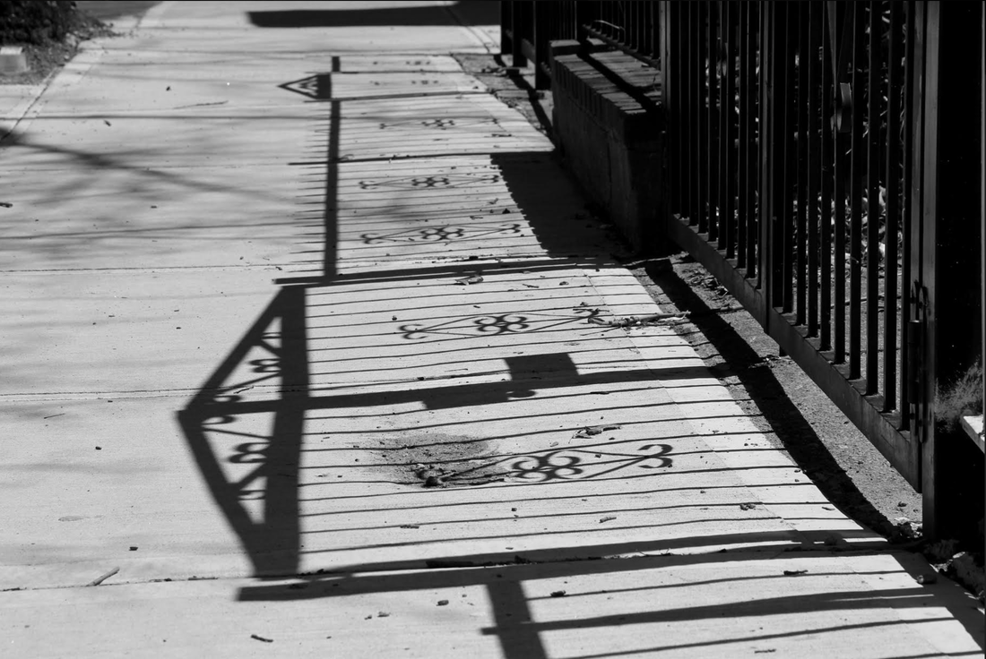 Shadow of a gate on the ground